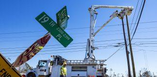 Tampa Electric crews repair lines damaged by Hurricane Michael in Panama City, Florida