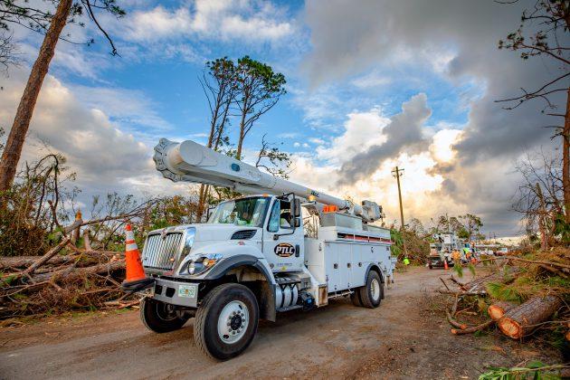 PowerTown Line Construction crews work to help Gulf Power restore power in Lynn Haven, Florida after Hurricane Michael