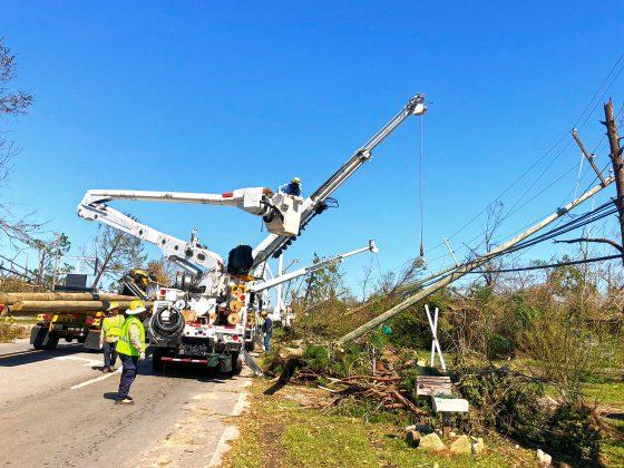 Tampa Electric repairing poles damaged from Hurricane Michael in Panama City, Florida